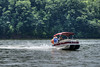 A boat jets along South Holston Lake near Abingdon, VA on Sunday, June 9, 2013. Copyright 2013 Jason Barnette
