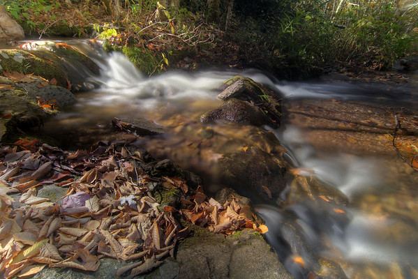 Water tumbles over rocks beside the stone swimming pool at Grindstone Campground in Troutdale, VA on Sunday, October 19, 2014. Copyright 2014 Jason Barnette