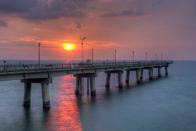 A warm sunset shines underneath the fishing pier at South Thimble Island along the Chesapeake Bay Bridge-Tunnel in Cape Charles, VA on Tuesday, August 18, 2015. Copyright 2015 Jason Barnette