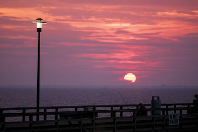 A colorful sunset over the pier at South Thimble Island along the Chesapeake Bay Bridge-Tunnel in Cape Charles, VA on Tuesday, August 18, 2015. Copyright 2015 Jason Barnette