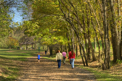 People walk their pets and jog along the Virginia Creeper Trail in Abingdon, VA on Monday, October 27, 2014. Copyright 2014 Jason Barnette