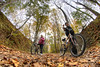 A pair of ladies take a break from riding their bicycles to push them along the Virginia Creeper Trail in Abingdon, VA on Friday, October 24, 2014. Copyright 2014 Jason Barnette