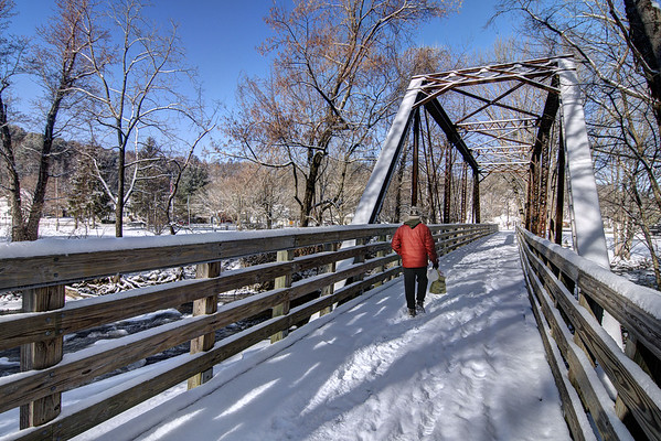 A man walks along a snow-covered Trestle #16 on the Virginia Creeper Trail in Damascus, VA on Wednesday, January 29, 2014. Copyright 2014 Jason Barnette