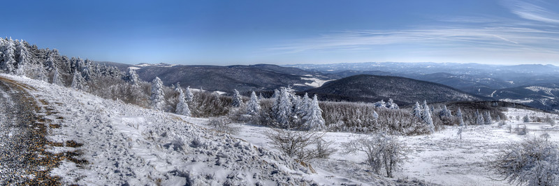 A sweeping panorama view of Mount Rogers (left), Wilburn Ridge, and beyond from Whitetop Mountain in Whitetop, VA on Friday, February 14, 2014. Copyright 2014 Jason Barnette  Whitetop Mountain is the highest place in Virginia you can drive at 5,552', second in height only to nearby Mount Rogers. The top of the mountain is accessible by a gravel road, managed by the National Park Service, and open year-round to day-use visitors.