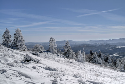 Snow covers the evergreens and landscapes near the summit of Whitetop Mountain in Whitetop, VA on Friday, February 14, 2014. Copyright 2014 Jason Barnette  Whitetop Mountain is the highest place in Virginia you can drive at 5,552', second in height only to nearby Mount Rogers. The top of the mountain is accessible by a gravel road, managed by the National Park Service, and open year-round to day-use visitors.