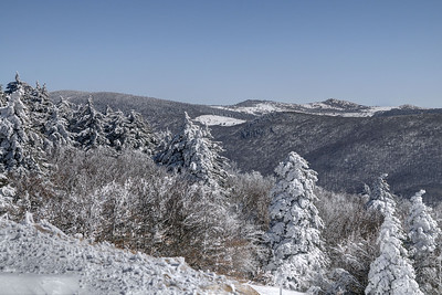A view of Mount Rogers (left) and Wilburn Ridge (right three peaks) from Whitetop Mountain in Whitetop, VA on Friday, February 14, 2014. Copyright 2014 Jason Barnette  Whitetop Mountain is the highest place in Virginia you can drive at 5,552', second in height only to nearby Mount Rogers. The top of the mountain is accessible by a gravel road, managed by the National Park Service, and open year-round to day-use visitors.