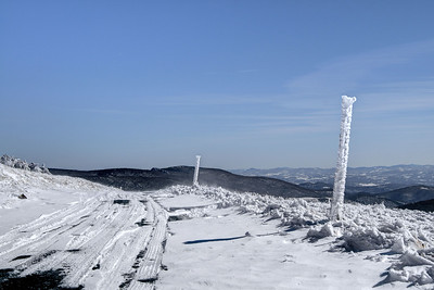 Snow-covered posts used to mark the path of the road when covered with heavy snow near the summit of Whitetop Mountain in Whitetop, VA on Friday, February 14, 2014. Copyright 2014 Jason Barnette  Whitetop Mountain is the highest place in Virginia you can drive at 5,552', second in height only to nearby Mount Rogers. The top of the mountain is accessible by a gravel road, managed by the National Park Service, and open year-round to day-use visitors.