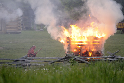 A small building burns during the night raid at the 15th Annual Raid at Martin's Station at Wilderness Road State Park in Ewing, VA on Saturday, May 9, 2015. Copyright 2015 Jason Barnette