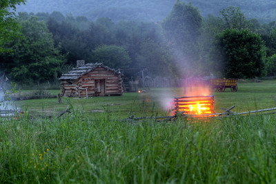 A fire continues to burn after the conclusion of the night raid at the 15th Annual Raid at Martin's Station at Wilderness Road State Park in Ewing, VA on Saturday, May 9, 2015. Copyright 2015 Jason Barnette