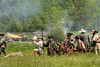 Colonial reenactors prepare to fire a small canon during the raid at the 15th Annual Raid at Martin's Station at Wilderness Road State Park in Ewing, VA on Saturday, May 9, 2015. Copyright 2015 Jason Barnette