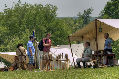 Visitors chat with sutlers during the 15th Annual Raid at Martin's Station at Wilderness Road State Park in Ewing, VA on Saturday, May 9, 2015. Copyright 2015 Jason Barnette