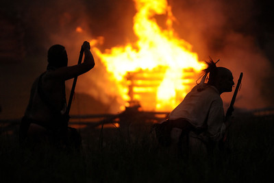 Native American reenactors move to attack near a burning building during the night raid at the 15th Annual Raid at Martin's Station at Wilderness Road State Park in Ewing, VA on Saturday, May 9, 2015. Copyright 2015 Jason Barnette