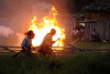 Native American reenactors run past a burning building during the night raid at the 15th Annual Raid at Martin's Station at Wilderness Road State Park in Ewing, VA on Saturday, May 9, 2015. Copyright 2015 Jason Barnette