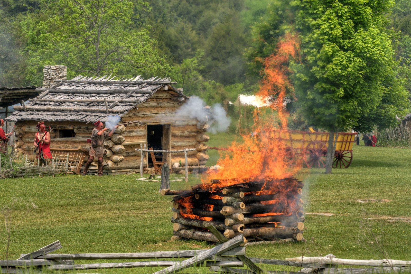 A fire burns during the raid at the 15th Annual Raid at Martin's Station at Wilderness Road State Park in Ewing, VA on Saturday, May 9, 2015. Copyright 2015 Jason Barnette