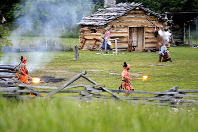 Native American reenactors run across a field with torches during the night raid at the 15th Annual Raid at Martin's Station at Wilderness Road State Park in Ewing, VA on Saturday, May 9, 2015. Copyright 2015 Jason Barnette