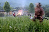 A Native American reenactor runs across a field in retreat during the night raid at the 15th Annual Raid at Martin's Station at Wilderness Road State Park in Ewing, VA on Saturday, May 9, 2015. Copyright 2015 Jason Barnette