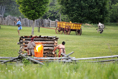 Native American reenactors light a small building on fire during the night raid at the 15th Annual Raid at Martin's Station at Wilderness Road State Park in Ewing, VA on Saturday, May 9, 2015. Copyright 2015 Jason Barnette