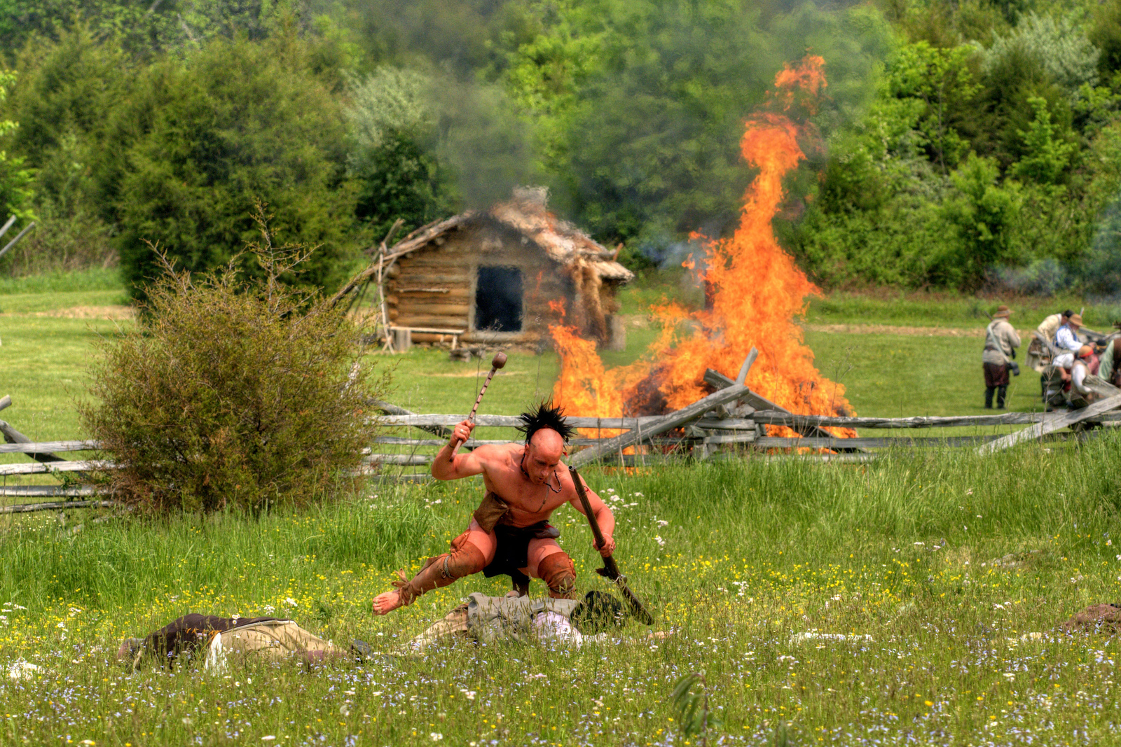 A Native American reenactor attacks an