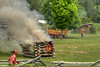 A small building is set on fire during the raid at the 15th Annual Raid at Martin's Station at Wilderness Road State Park in Ewing, VA on Saturday, May 9, 2015. Copyright 2015 Jason Barnette