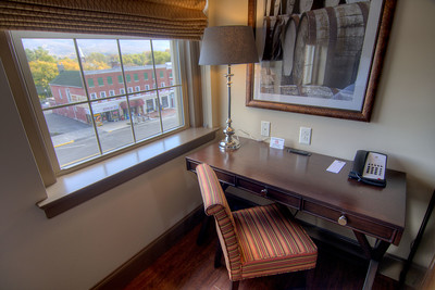 A desk with a view of the building across the street where Edith Wilson was born, seen from a room at the Bolling Wilson Hotel in Wytheville, VA on Thursday, October 23, 2014. Copyright 2014 Jason Barnette