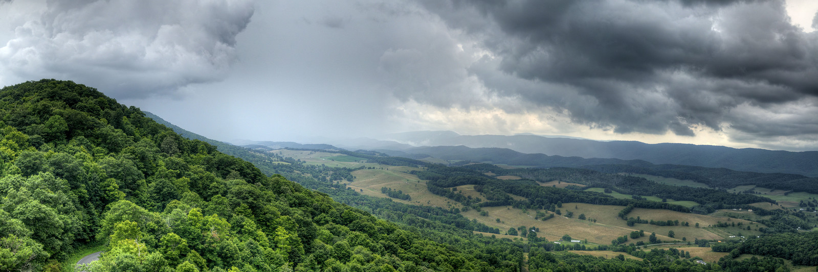 An epic summer thunderstorm rolls across the valley below the Big Walker Lookout, a locally-owned 100' observation tower on top of Big Walker Mountain along scenic Highway 52, in Wytheville, VA on Wednesday, July 23, 2014. Copyright 2014 Jason Barnette