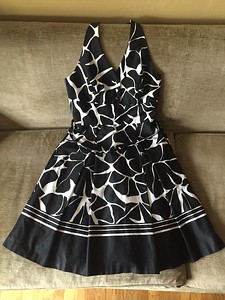 White House Black Market halter top dress in giraffe print with full skirt size 6