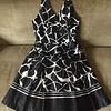 White House Black Market halter top dress in giraffe print with full skirt size 6