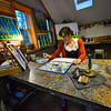 KRISTOPHER RADDER — BRATTLEBORO REFORMER<br /> Fiona Morehouse, owner of Fiona Grace Morehouse, in Putney, Vt., works on a painting that was inspired by the COVID-19 pandemic on Thursday, April 30, 2020. Morehouse has been using nature scenes and mixing them with current feelings that stem from the virus.