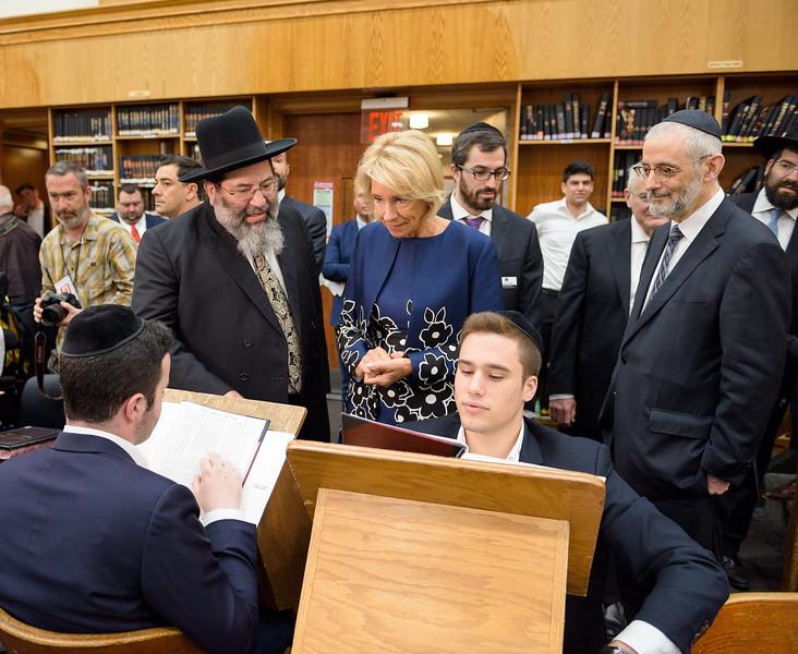 Secretary DeVos observes a pair of chavrusos learning at Yeshiva Darchei Torah as Rabbi Yaakov Bender (left) explains the study system.