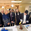 Yehuda Reisman demonstrates his skills at the Weiss Vocational Center of Yeshiva Darchei Torah. Looking on, L-R: Rabbi Chaim Dovid Zwiebel, Mr. Ronald Lowinger, Education Secretary Betsy DeVos, Rabbi Eli Biegeleisen, Rabbi Moshe Lubart and Rabbi Yaakov Bender.