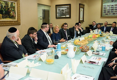 Education Secretary Betsy DeVos at a roundtable meeting with parents, teachers, alumni and board members of Yeshiva Darchei Torah. Visible, from left to right: Yussie Ostreicher, Rabbi Zvi Bloom, Rabbi Baruch Rothman, Rabbi Avraham Schachner (background), Secretary DeVos, Rabbi Eli Biegeleisen, Rabbi Moshe Bender, Rabbi Zev Bald, Betzalel Krasnow, Rabbi Avrohom Bender, Moti Hellman and Michael Fragin.