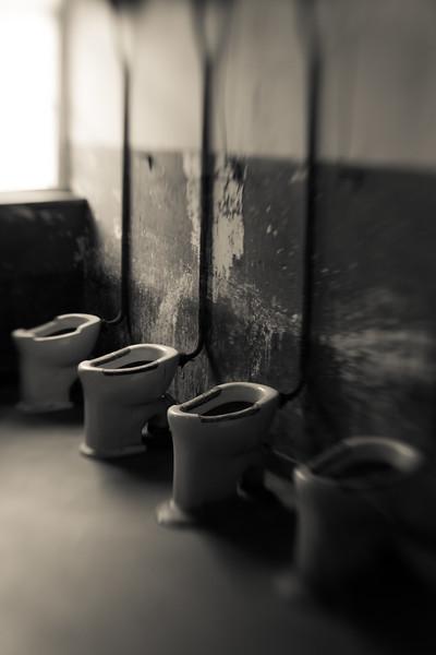 Ceramic toilets in the Auschwitz barracks.