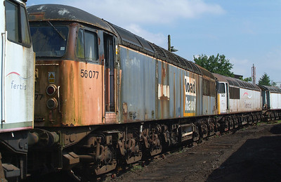 Hmm ! 56077 proudly carrying LOADHAUL , or maybe not so proudly these days. Another Fertis one, 56038 behind.