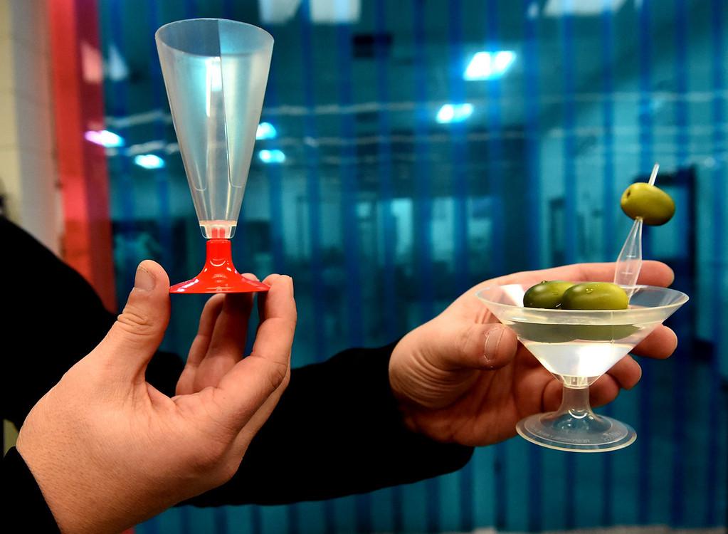 . Mishek shows biodegradable champagne and martini glasses that Vista Tek makes. (Pioneer Press: Jean Pieri)
