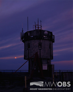 Moon setting behind the weather observation tower.