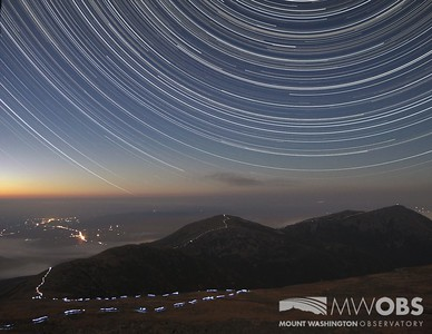 Star trails above a hiker traversing the northern peaks the night of October 12-13, 2013.