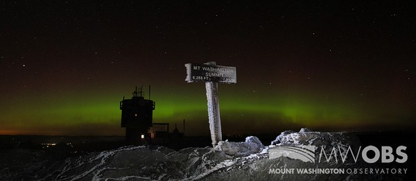 Summit Sign With The Northern Lights