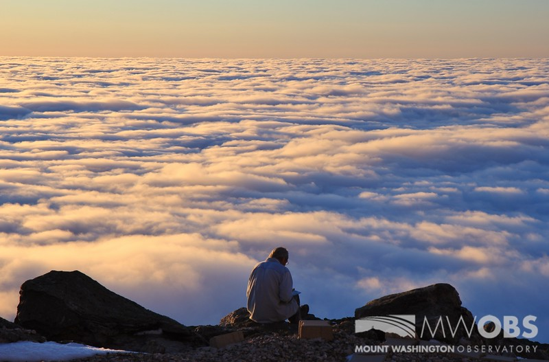 Man sitting and enjoying Undercast at Sunset