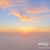 Sunset Through Gaps in the Fog
