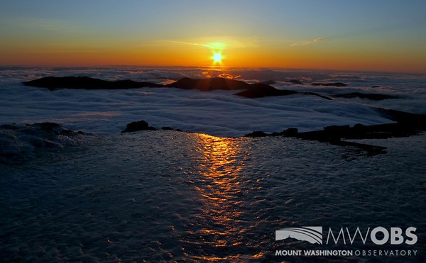 Sunrise over an undercast as the suns light reflect off some recent ice.