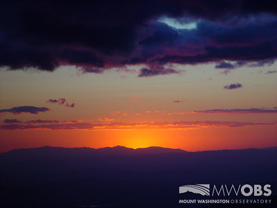 The sun setting behind the Green Mountains in Vermont (as viewed from the summit of Mount Washington).