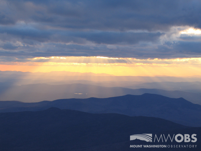 Crepuscular rays spreading down over Mt. Martha (Cherry Mountain).