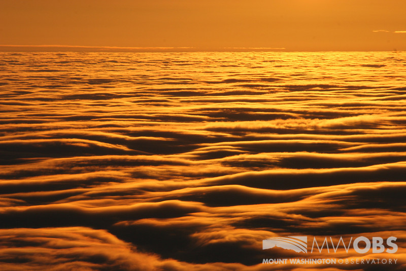 A sea of clouds formed by and undercast to our east during a winter sunrise.