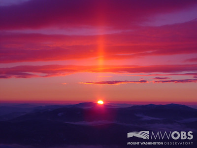 Sun pillar formation during a summer sunrise.