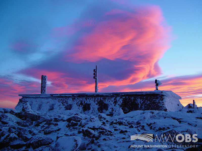 Standing lenticular clouds over Tip Top house during an early winter sunset.
