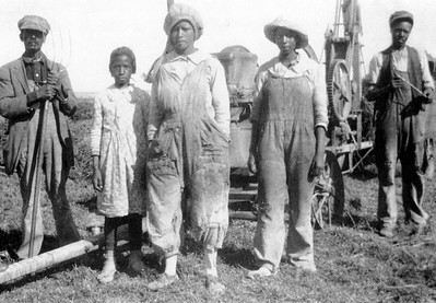 This is a photo, circa 1920, of Blackdom residents, identified from left, as Loney K. Wagner, three daughters of Joseph and Harriet Smith, not pictured, and an unknown man. (Courtesy of the Historical Society for Southeast New Mexico)
