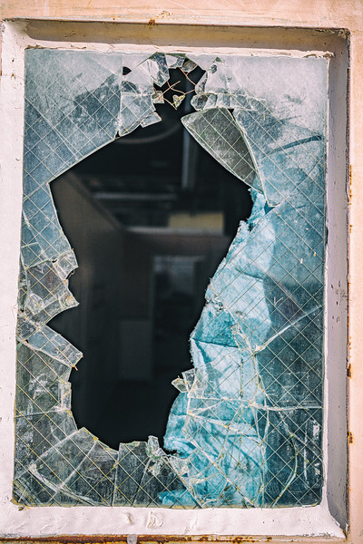 Another broken window offers a glimpse of lockers, a break room and more at the transportation hub.