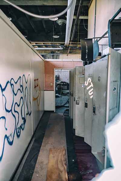 Particularly haunting images of open lockers, some with names on them.