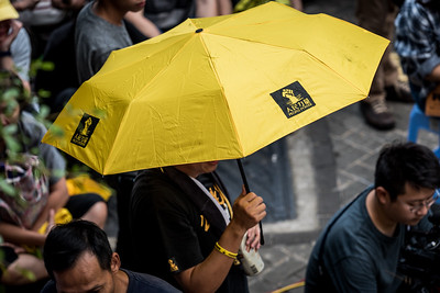 A participant holds a yellow umbrella at an event commemorating the 4th anniversary of the Umbrella Revolution in Hong Kong on September 28, 2018.