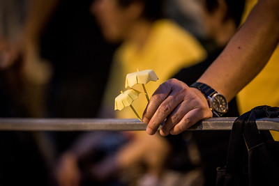 A participant holds two yellow umbrellas at an event commemorating the 4th anniversary of the Umbrella Revolution in Hong Kong on September 28, 2018.